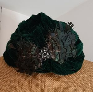 Green velour turban / hat with feather.